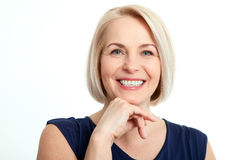 friendly smiling middle aged business woman isolated white background 70503214 - CONTACT US